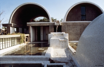 1980: Sangath, Ahmedabad One of the best examples of his building style, it combines a green enclave of grassy mounds with steps, terraces, water cascades and earth hugging vaults covered in chips of china mosaic.