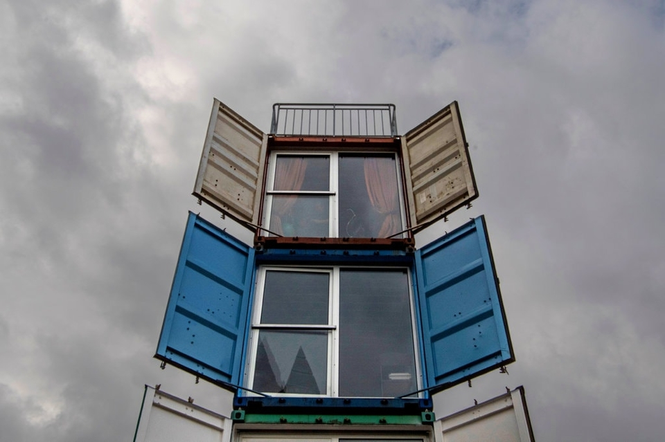 """An installation called """"Container Tower"""" made out of furnished shipping containers at the Frankfurt Book Fair in Germany in 2017."""