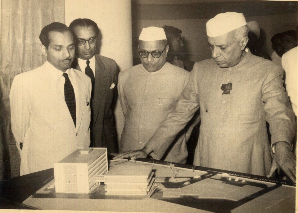 Prime Minister Jawaharlal Nehru viewing the design model for the first scheme, A.P. Kanvinde to the left