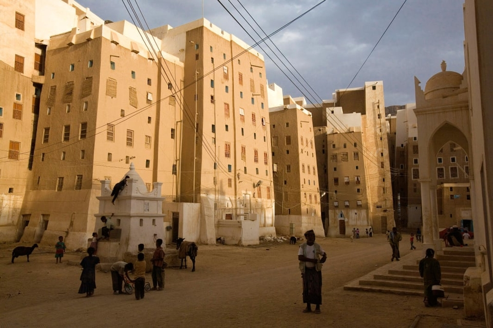 The shadows cast by Shibam's high-rises provide shade for the hot streets below