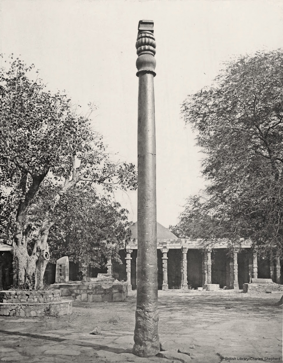 The Masjid-i-Kutb-ul-Islam. View of the Iron Pillar from the west